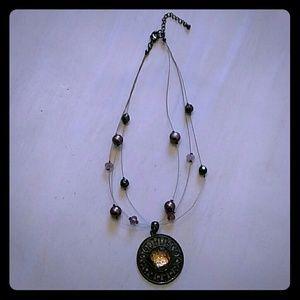 Beautiful light purple, grey, and amber necklace.